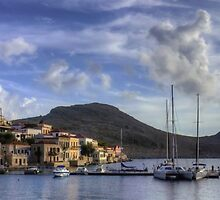 Yachts at the small pier by Tom Gomez