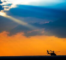 Apache AH-644 Longbow (Seraph) Helicopter at sunset by PhotoStock-Isra
