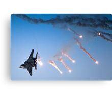 IAF F-15I Fighter in flight Emitting anti-missile flares Canvas Print