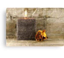 black candle and faded rose Canvas Print