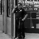 Security Officer on Broadway St. in Los Angeles. by philw