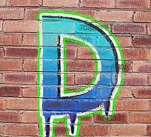 Graffiti Printed Letter D on wall by Jack Hickling
