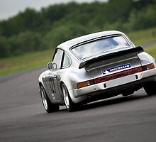 Silver Porsche 911 racing car by Martyn Franklin