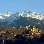First sumbeams on Sion castle - Switzerland by Arie Koene