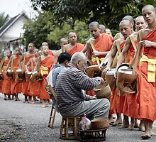 Morning alms procession in Luang Prabang by DebWinfield
