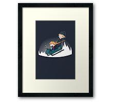A Snowy Ride Framed Print