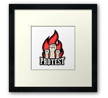 raised fist held in protest Framed Print