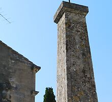 A cross at Les Baux  by milyon