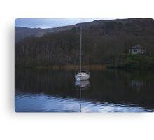 White boat on a dark lake Canvas Print