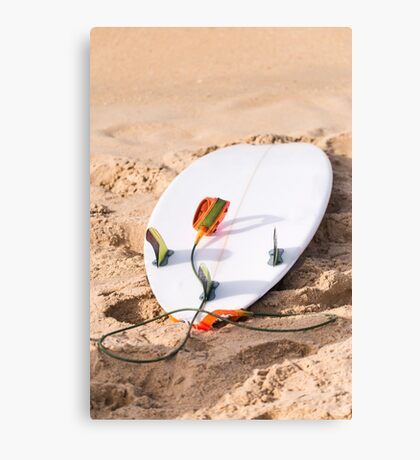 Surfboard on beach Canvas Print