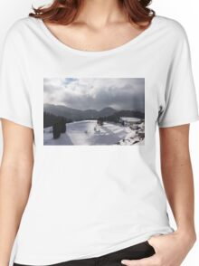 Snowstorm in the Sun - Dancing Snowflakes, Moody Clouds, Long Shadows Women's Relaxed Fit T-Shirt