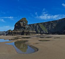 Smooth sandy beach with cliffs and blue sky by Brooxi