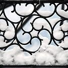 Wrought iron filled with snowflakes by Arie Koene