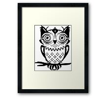 An owl sitting on a branch  Framed Print
