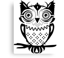 An owl sitting on a branch  Canvas Print