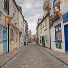 whitby main street at 5 am  by simon sugden