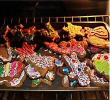 Christmas Cookies in the Oven Photographic Print