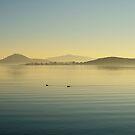 Tranquil winter evening, Lago Trasimeno from Monte del Lago, Umbria, Italy by Andrew Jones