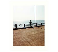 Lonely Man Sitting On Railing By The Ocean Art Print