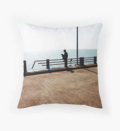 Lonely Man Sitting On Railing By The Ocean Throw Pillow