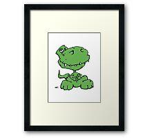 Funny sitting Dinosaur Framed Print