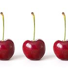 Three Red Cherries against a White Background by Natalie Kinnear