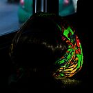 Woman with Scarf on the Bus by Mark Jackson
