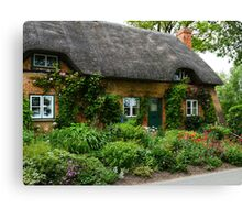 A Cottage with Flowers Canvas Print