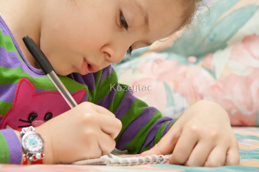 Little Girl Drawing Flowers On A Notebook by Kuzeytac