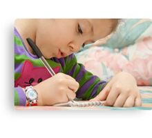 Little Girl Drawing Flowers On A Notebook Canvas Print