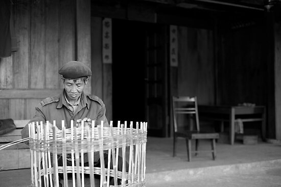 Man weaving baskets, Sapa, Vietnam by paulsborrett
