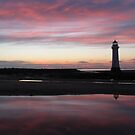 LIGHTHOUSE AT SUNSET by gothgirl
