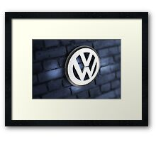 Vw Badge on an old blue wall Framed Print