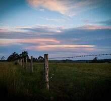 Sunset on the fence line by Rose Hamilton-Barr