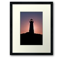 Lighthouse during sunrise in the early morning Framed Print