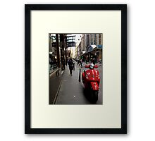 A splash of red in a sea of grey Framed Print