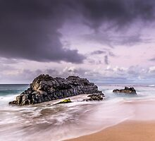 Cloudy sky and lonely Rocks in Kauai by Attilio Ruffo