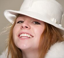 Redhead smiling in white felt hat and fur by Nick Dale