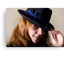 Redhead smiling in black hat touching brim Canvas Print