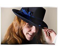 Redhead smiling in black hat touching brim Poster