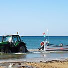 Bringing the catch ashore. by Arie Koene