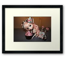 Greedy doll Framed Print