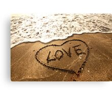 Love concept handwritten on sand Canvas Print