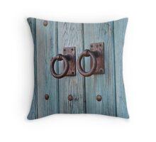 Handles on a blue door Throw Pillow