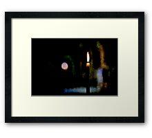 Firing candle in a dark church Framed Print