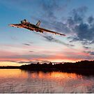 Vulcan low over a sunset lake by Gary Eason
