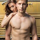 Friendly couple in front of a wrecking yard crane truck by Ben Ryan