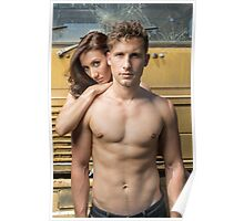 Friendly couple in front of a wrecking yard crane truck Poster