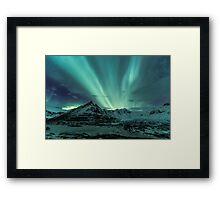 Aurora Borealis over glacier Framed Print