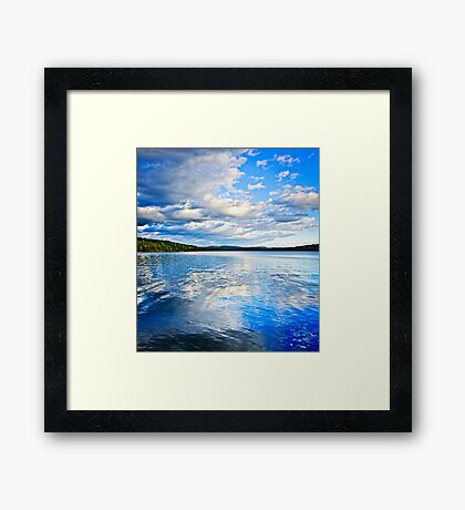 Lake reflecting sky Framed Print